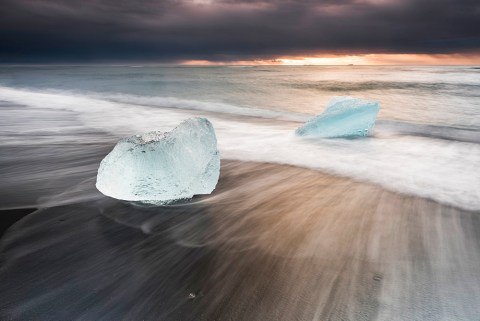 Icebergs at sunrise on Jokulsarlon Beach, a black volcanic sand beach in South East Iceland, Iceland, Polar Regions