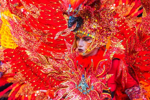 Stock photo of a colourful performer at Jember Fashion Festival and Carnival, East Java