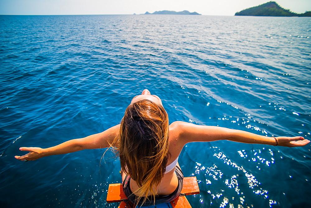 Stock travel photo: Girl on boat in Sumatra, Indonesia