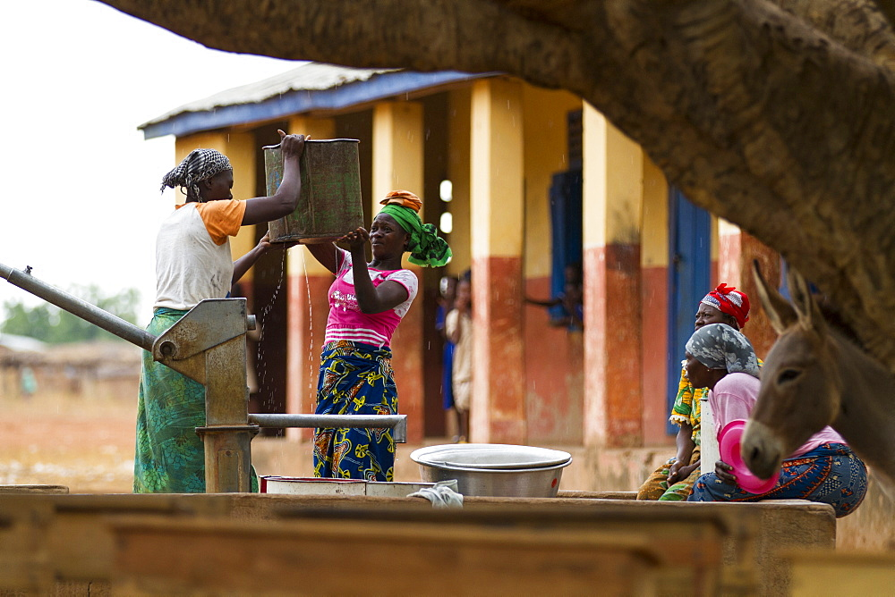 Stock photo of Women collecting water in Ghana
