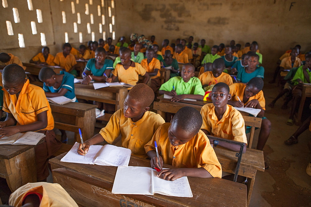 Stock photo of A classroom full of students learning at a primary school in Ghana