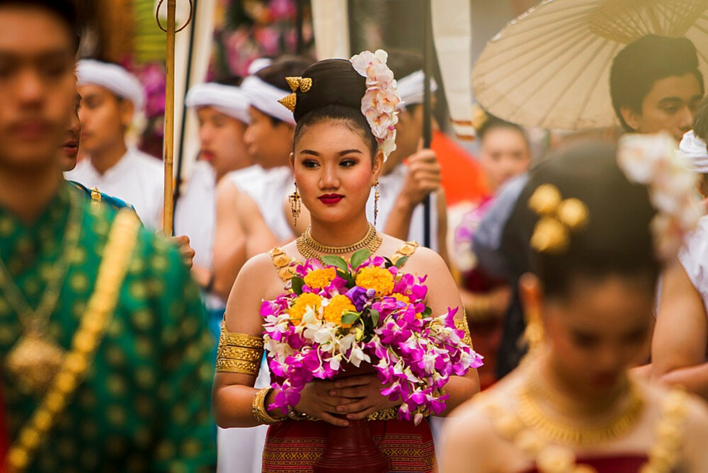 Girl holding flowers at Chiang Mai Flower festival