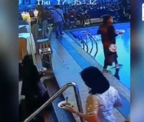 VIDEO: ડાફોડીયા મારવાની હદ વટાવી, આ બહેન સીધા સ્વિમિંગ પુલમાં ખાબક્યાં