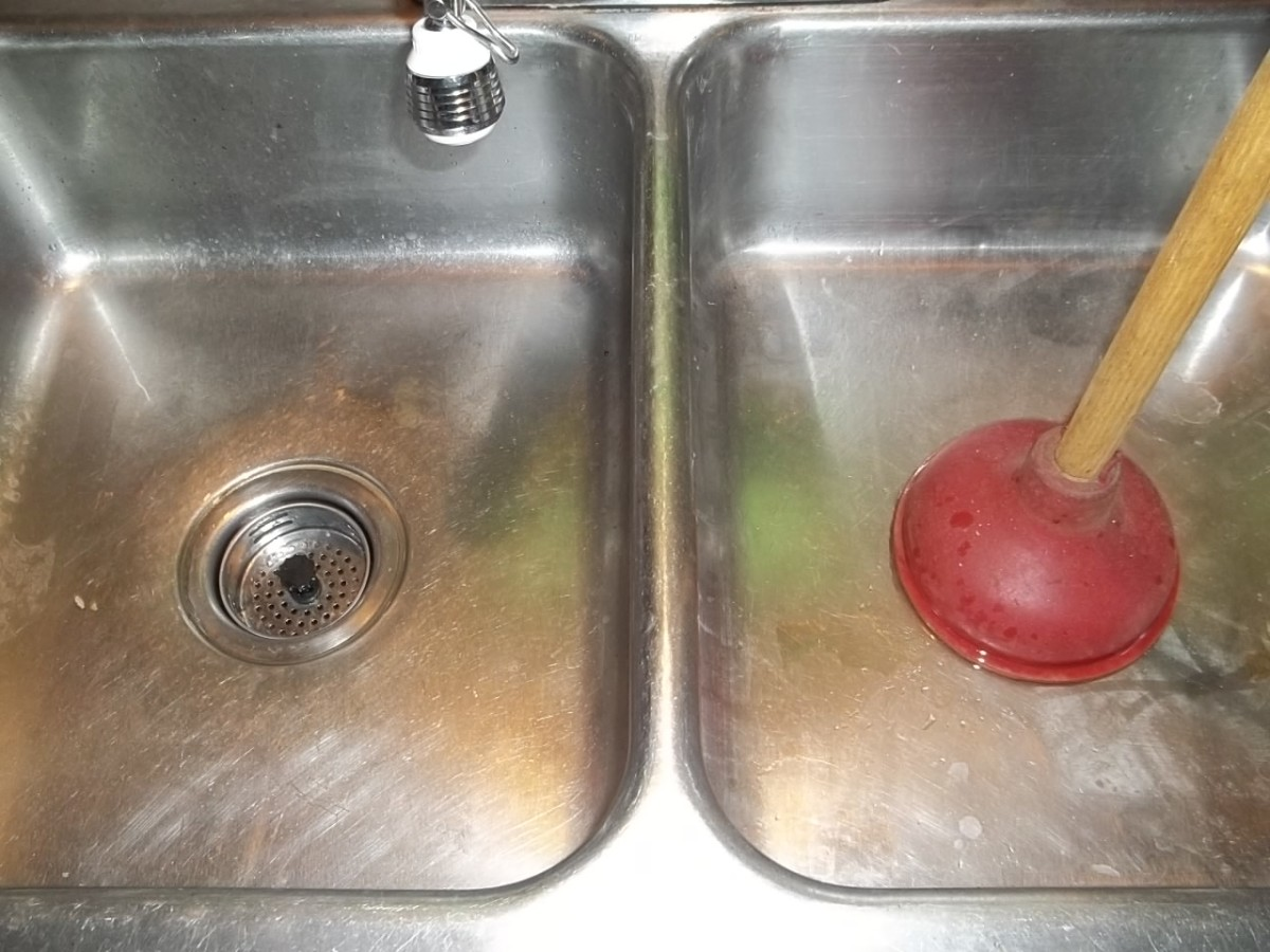 to unclog a double kitchen sink drain
