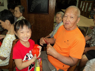 Go to the local old folks home and give them some mandarine oranges, and CNY joy