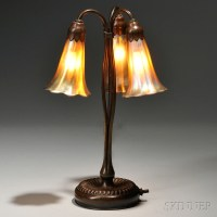 Realized price for Tiffany Studios Three-light Lily Lamp