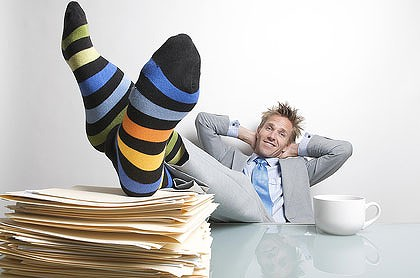 Image result for guy feet up on table slacking