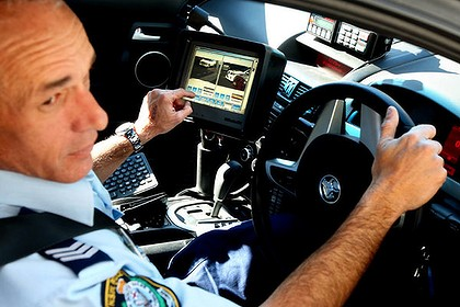 Sergeant Matt Rees from Mount Druitt police pictured with the newly fitted Automatic Number Plate Recognition system.