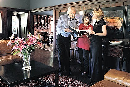 Architect Peter Crone and his wife Jane (centre) with the National Trust's Tracey Avery.