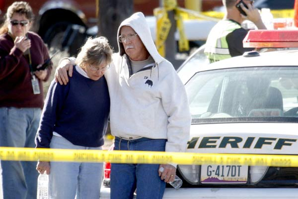 Bystanders gather at the shopping centre where a gunman opened fire.