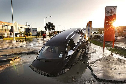 Submerged  ... a car stands in water after eysterday's aftershocks.