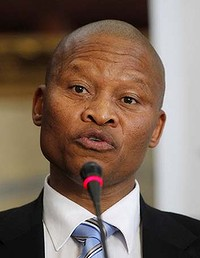 Justice Mogoeng Mogoeng speaks after South Africa's president Jacob Zuma appointed him as the new Chief Justice of South Africa at the presidential guest house in Pretoria September 8, 2011.  REUTERS/Siphiwe Sibeko (SOUTH AFRICA - Tags: POLITICS CRIME LAW HEADSHOT)