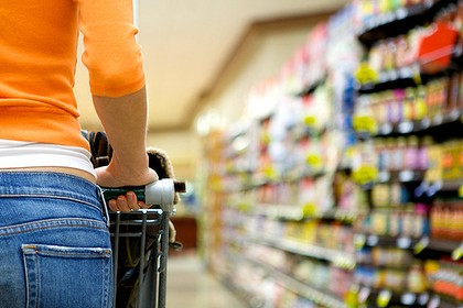 Generic pic of a woman shopping for groceries at the supermarket, shopping trolley.