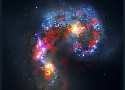 The antennae galaxies (also known as NGC 4038 and 4039) are seen in this image made from the parabolic antennas of the ALMA project.