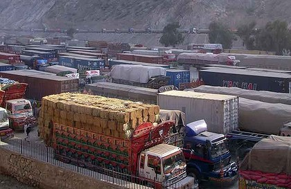 Cargo trucks, including those carrying supplies to NATO forces, are halted at the Pakistan-Torkham border as Pakistanis protest against the air strikes that killed 25 soldiers.