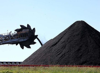 Coal Loader working at Newcastle depositing mountains of coal from mining to be shipped overseas.