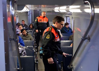 Transit Officers working for City Rail check for fare evaders on the inner west line.21 July 2011Photograph: Jon Reid