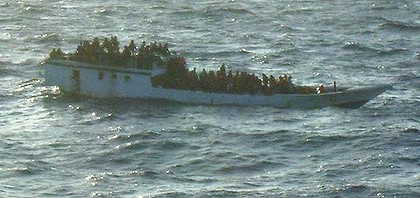 The overloaded boat before it capsized, pictured by  the merchant vessel MV Bison Express mid-morning.