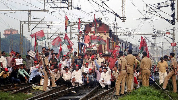 Samajwadi Party activists block a train during a strike in Allahabad, India.
