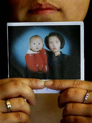 Korean adoptee - the truth about Korean adoption process. Pictured is adoptee Kim Myung Soo as a baby with her sister in Korea. 12trh October 2012. photo: Steven Siewert