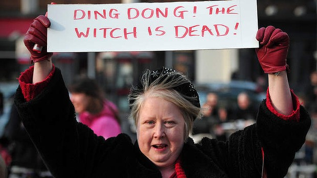 A women celebrates the death of the former British PM.