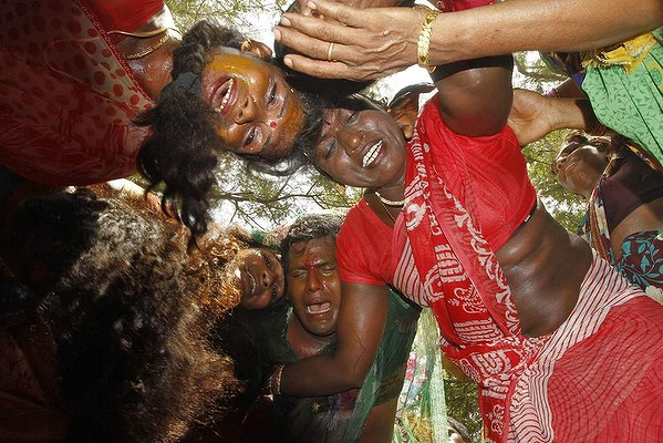Transgender people go into trance as they mourn the death of warrior god Aravan during the annual eunuch festival at Koovagam village, in the southern Indian state of Tamil Nadu. Transgenders and transvestites gather in the village every year to participate in the reenactment of the tale of Indian epic Mahabharata, in which they play the bride of warrior god Aravan and later mourn his death through ritualistic dances, according to a villager.