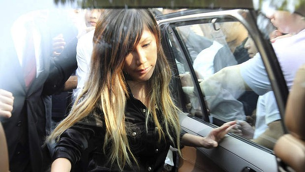 File photo of Singaporean pop music singer Ho Yeow Sun, popularly known as Sun Ho, getting in a car as she leaves the Subordinate Courts in Singapore in June 2012.