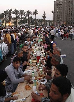 Families gather for a mass iftar (breaking fast) in Tahrir square  earlier this month.