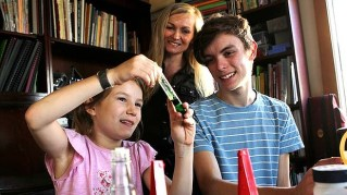 Lindy Hadges with two of her five children, Ruben, 15, and Odette, 8, whom she home schools in Carlton, Sydney.