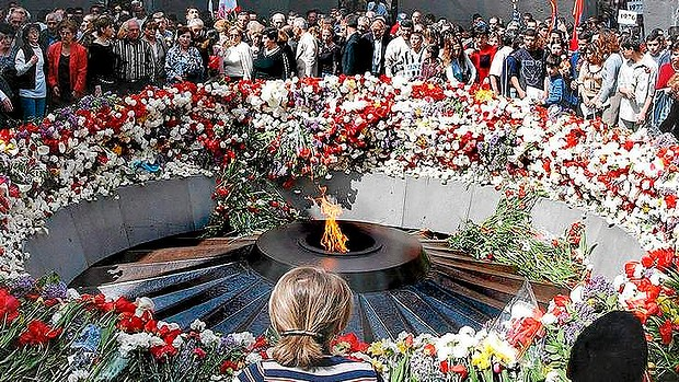 Armenians lay flowers at the Genocide Memorial in Yerevan. Professor Justin McCarthy's views on the   genocide, in which more than one million people are believed to have died at the hands of the Ottoman Empire between 1915 and 1923, have made him a controversial figure.