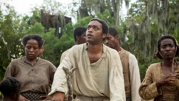 "Chiwetel Ejiofor, centre, in a scene from Steve McQueen ""12 Years A Slave,"" which also received seven Golden Globe Nominations."