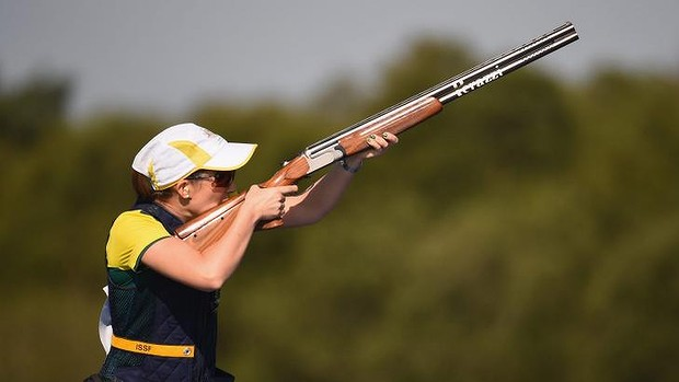 Gold medal effort ...  Laura Coles  of Australia competes in the Women's Skeet qualifying at Barry Buddon Shooting Centre.