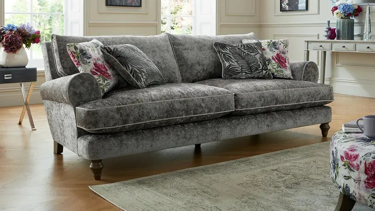 grey fabric sofa next mart chair and a half sofas corner sofabeds sofology maya with floral print cushions