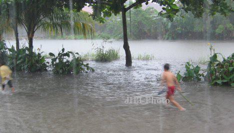 Ilustrasi banjir akibat tingginya curah hujan. (Article.wn.com)