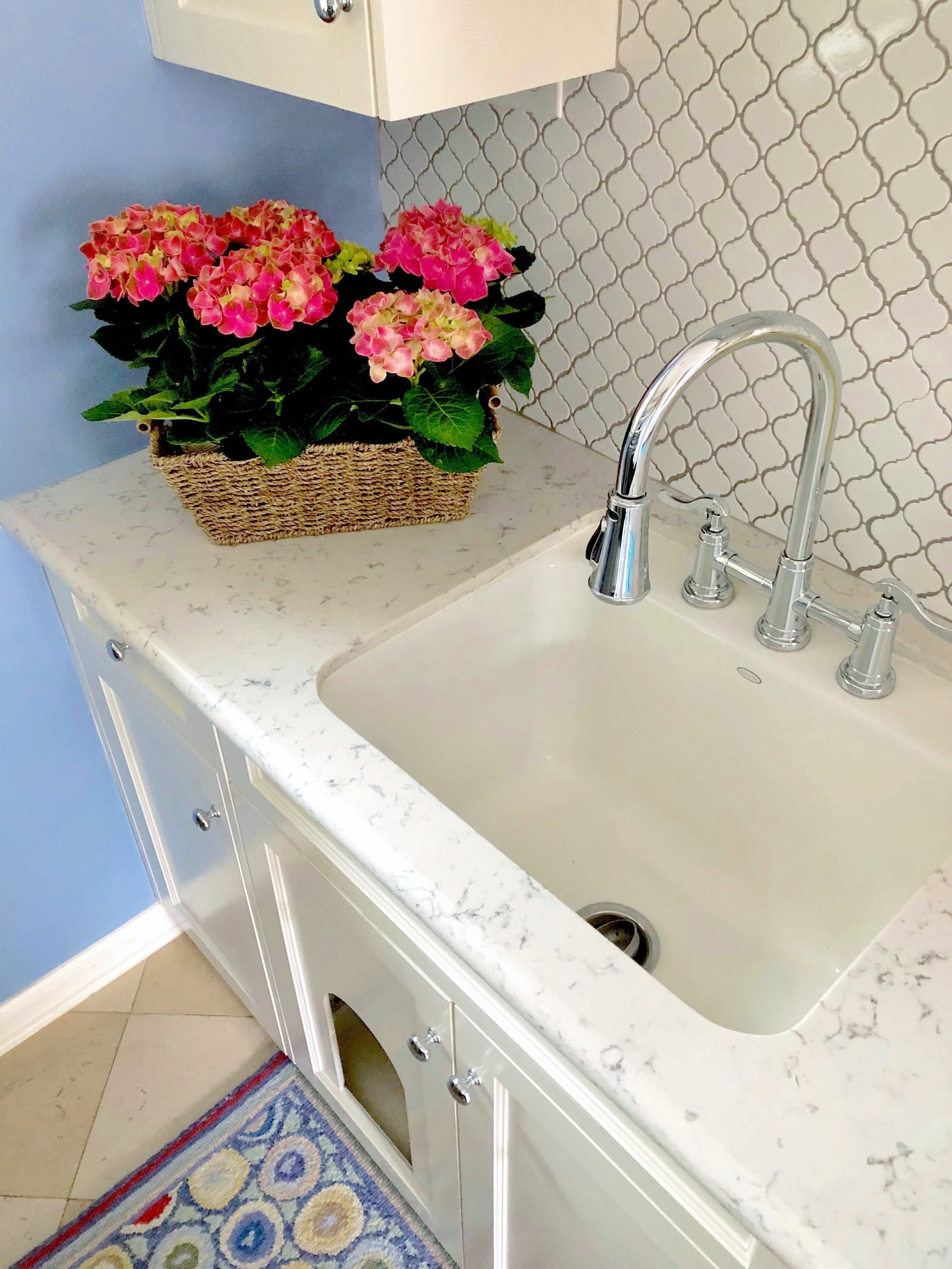 pretty laundry room in periwinkle blue