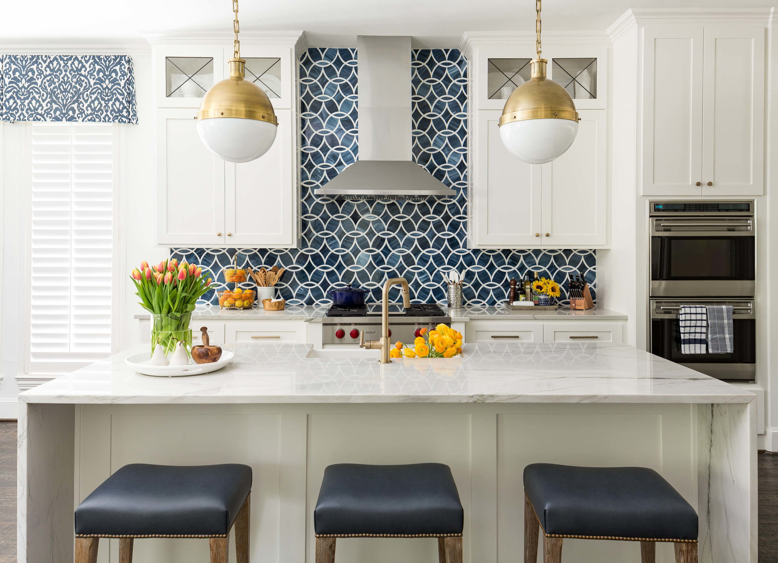 a dramatic kitchen and family room