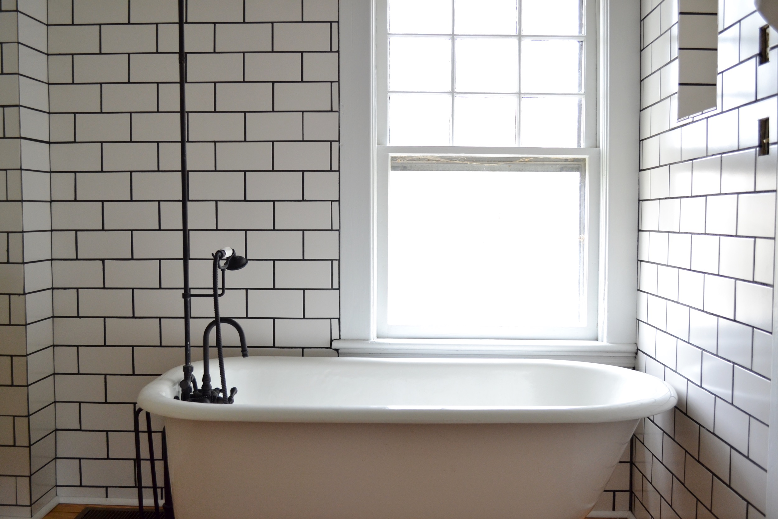 clawfoot tub shower