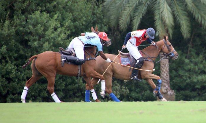 Pierre Henri Ngoumou of Casablanca out of the saddle to hook Pablo Pulido of Sebucan.