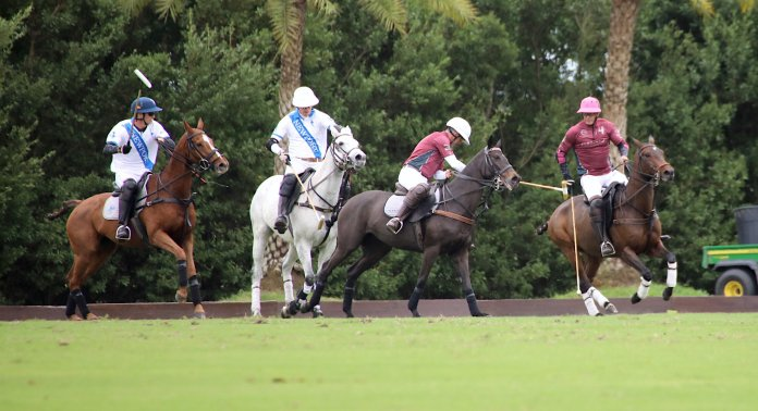 Horacio Heguy of Flexjet works the near side shot with Jason Crowder of Newport defending.