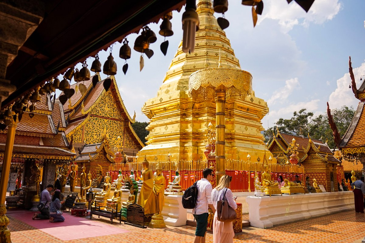 The beautiful golden Doi Suthep Buddhist Temple in the mountains above Chiang Mai, Thailand.