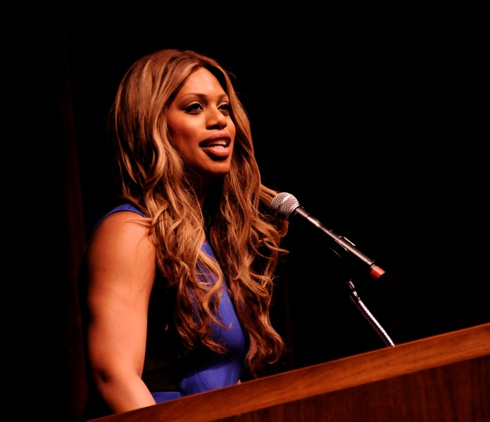 """Laverne Cox speaks at the podium at the Jorgensen Center on Wednesday, April 23, 2015. Cox is perhaps best known for her role in the Netflix original series  """"Orange Is the New Black.""""  (Brad Watson/The Daily Campus)"""