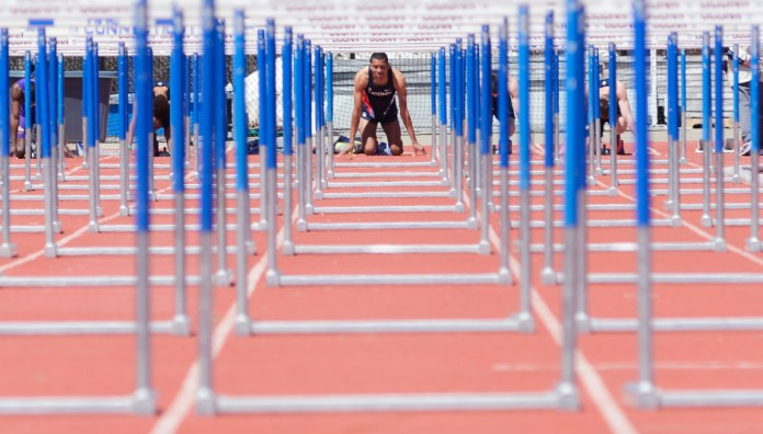 A hurdler from the UConn men's track team prepares at the starting line during a meet earlier this season. The Huskies will be looking for a solid showingat the prestigious Penn Relays this weekend. (Jason Jiang/The Daily Campus)