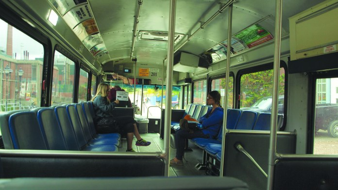 Students ride on a UConn Transportation bus.The buses on campus can be great options, especially on cold, rainy or snowy days. Tracking the buses can be done with several different smartphone apps. (File Photo/The Daily Campus)