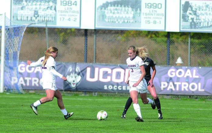 UConn women's soccer forward Rachel Hill (right) dribbles during the Huskies' game against Central Florida at Joseph J. Morrone Stadium on Oct. 19, 2014. The team, ranked No. 25 in the country, is the preseason favorite to win the American Athletic Conference. (File Photo/The Daily Campus)