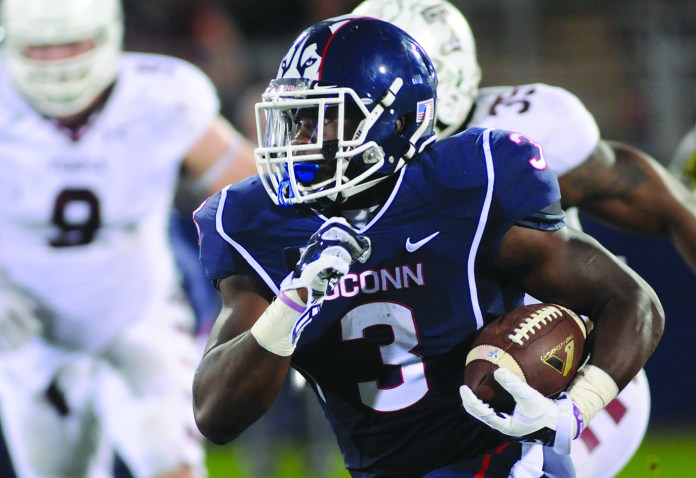 UConn running back Ron Johnson carries the ball during the Huskies' game against Temple last season at Rentschler Field in East Hartford, Connecticut on Sept. 27, 2014. The team will be looking to improve after finishing 123rd out of 125 teams in total offense last year. (File Photo/The Daily Campus)