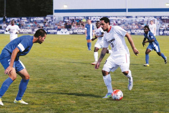 UConn sophomore defender Elliott Ackroyd dribbles up the field against St. Francis College during the Huskies' game at Joseph J. Morrone Stadium on Friday, Aug. 28, 2015. (Amar Batra/The Daily Campus)