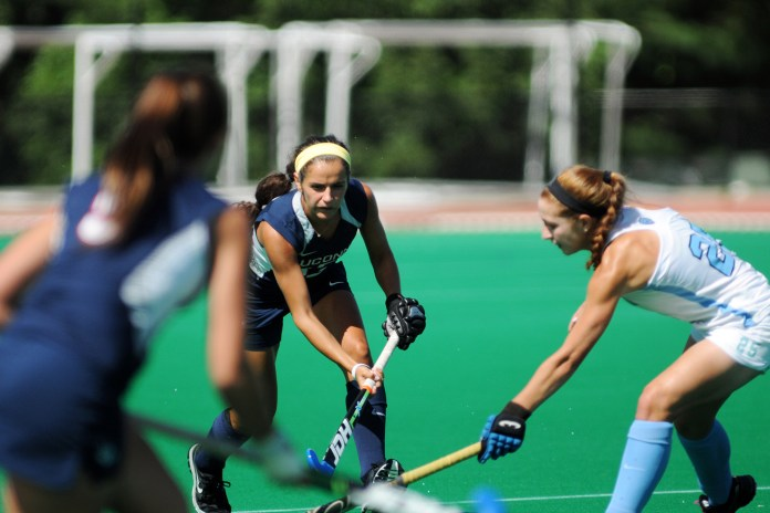 In this file photo, UConn field hockey midfielder Olivia Bolles handles the ball against North Carolina during the Huskies' game at the Sherman Family Sports Complex in Storrs, Connecticut. (Bailey Wright/The Daily Campus)