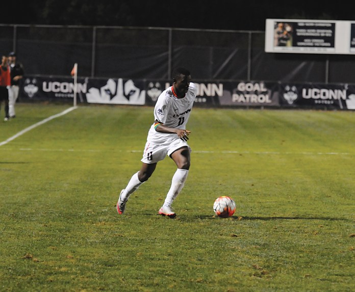 UConn freshman forward Abdou Mbacke Thiam dribbles the ball during the Huskies' game against Dartmouth on Friday, Sept. 4, 2015. Thiam helped create his team's best offensive chance of the night,sending a cross from the left wing into the box that found the head of teammate Alex Sanchez. (Amar Batra/The Daily Campus)