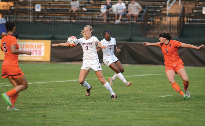 UConn women's soccer forward Rachel Hill (3) chests the ball during the Huskies' game against Syracuse at Joseph J. Morrone Stadium on Thursday, Sept. 3, 2015. (Jason Jiang/The Daily Campus)