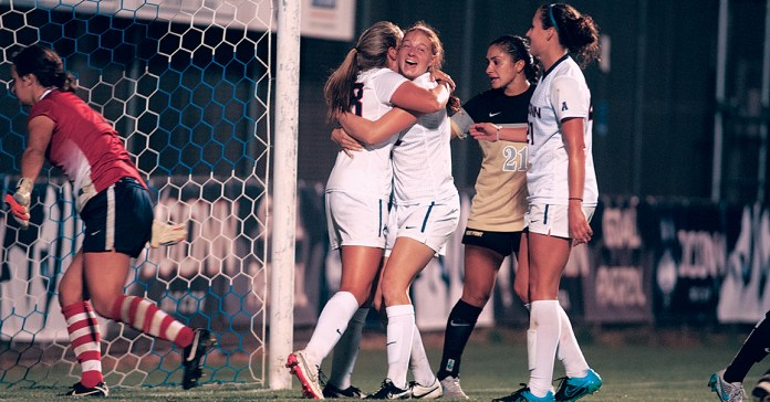Members of the UConn women's soccer team celebrate after scoring a goal against Army at Joseph J. Morrone Stadium in Storrs, Connecticut on Friday, Sept. 11, 2015. (Jackson Haigis/The Daily Campus)